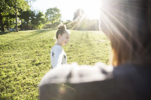 girl child standing outdoors under intense sunlight