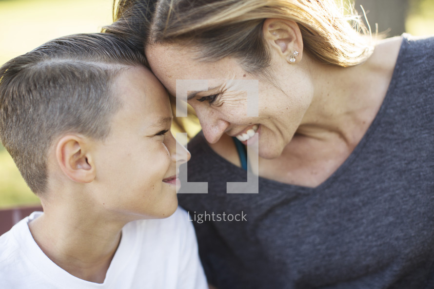 Mother and son bonding and smiling at each other.