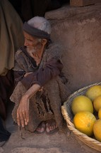 a poor man in biblical times sitting at a market