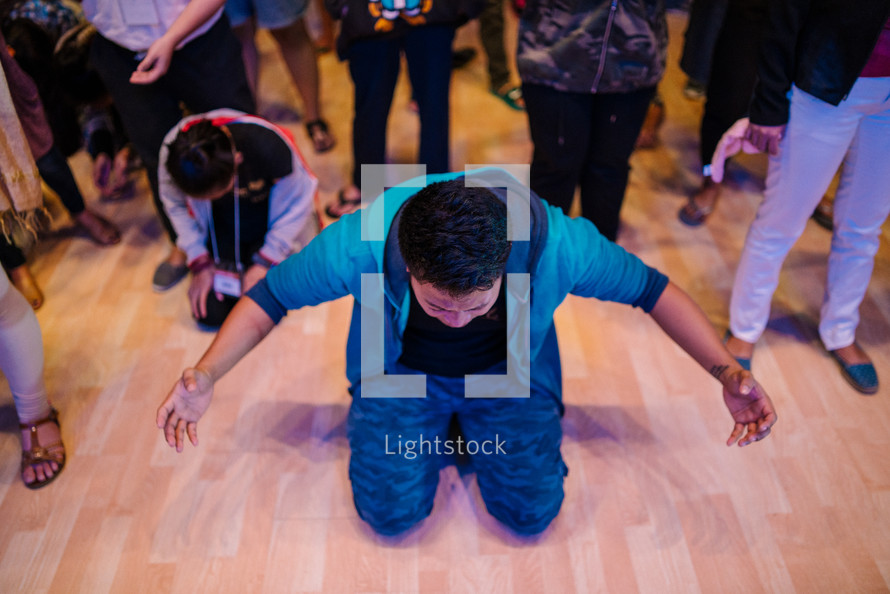 kneeling on the floor during a worship service