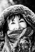 Smiling woman in winter coat with hood.