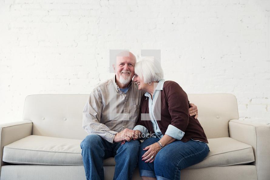 a happy, loving elderly couple