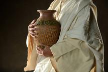 Jesus holding a pot