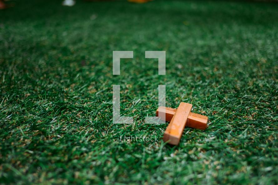 small cross on grass