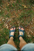 a woman's feet in sandals