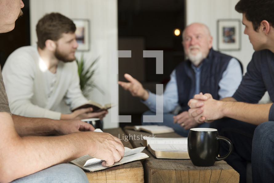 men in discussion at a Bible study.