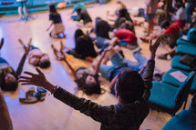 worshipers lying on the floor with hands raised