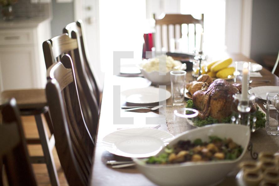 Table set for Thanksgiving dinner in home.