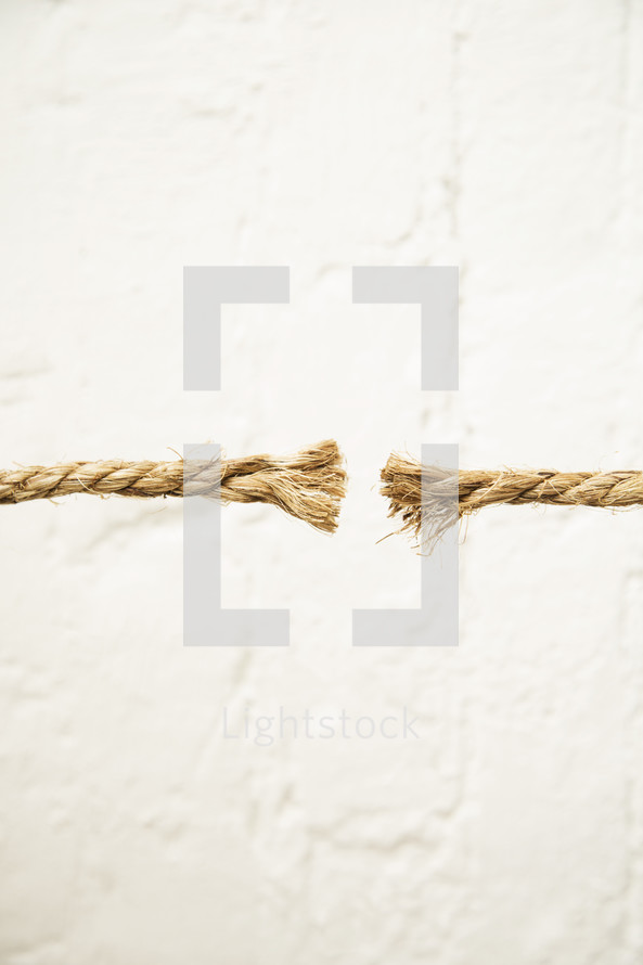 Frayed ends of a rope on a white background.