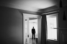 groom standing in a doorway