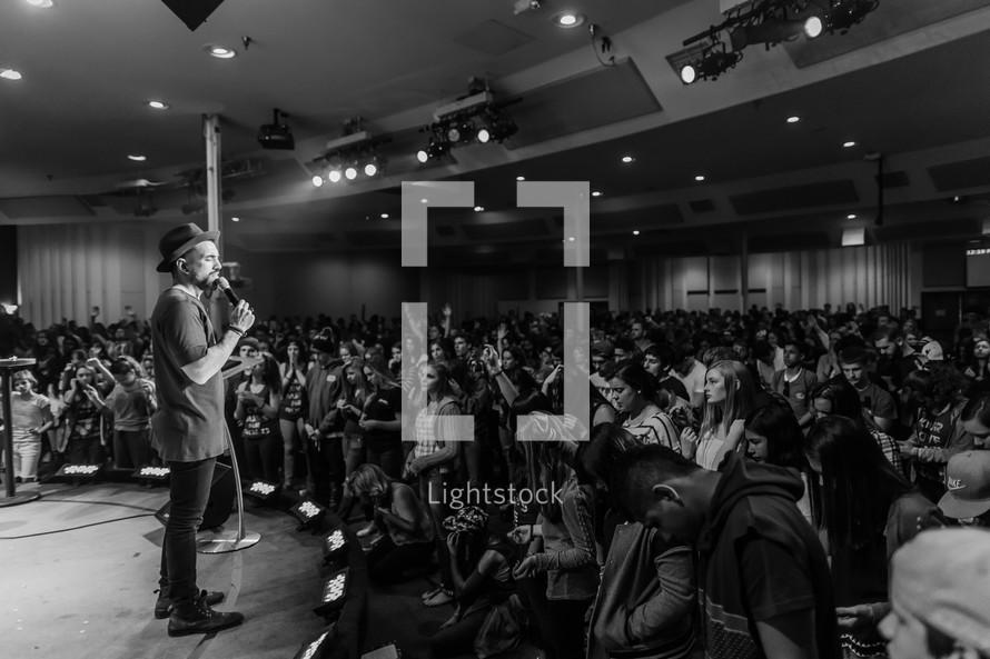 speaker, speaking, microphone, on stage, African American