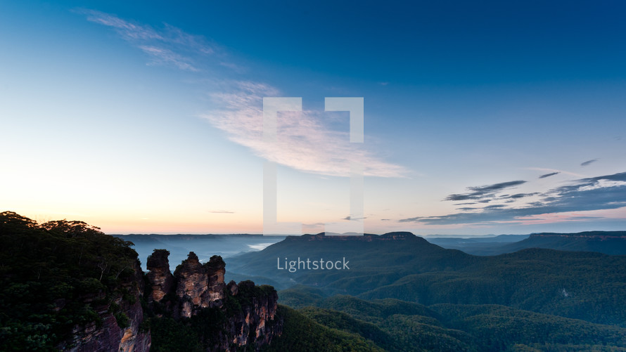rocky peaks and a mountain range. The Three Sisters. Blue Mountains World Heritage Area.