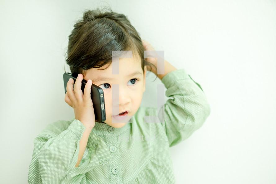 little girl talking on a cellphone