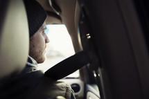 man wearing a seatbelt