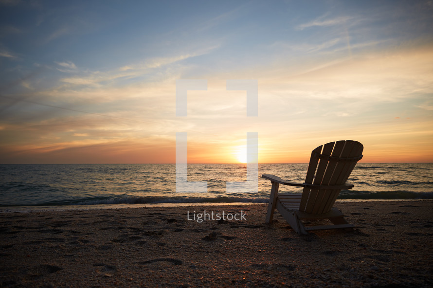 adirondack chair on a beach