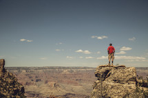 man standing looking out over the Grand Canyon