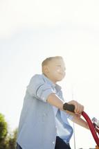 a little boy riding a bike