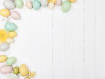 Easter egg border on a white background