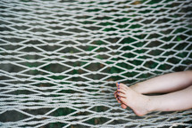 child's toes on a hammock