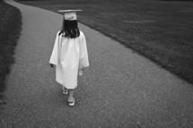 girl carrying a diploma