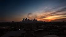 distant city skyline at sunset