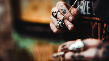 tattooed hands smoking