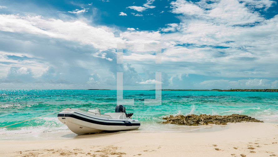 beached boat on a shoreline with turquoise waters