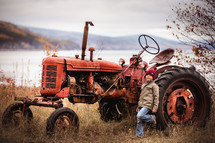 a little boy with a tractor
