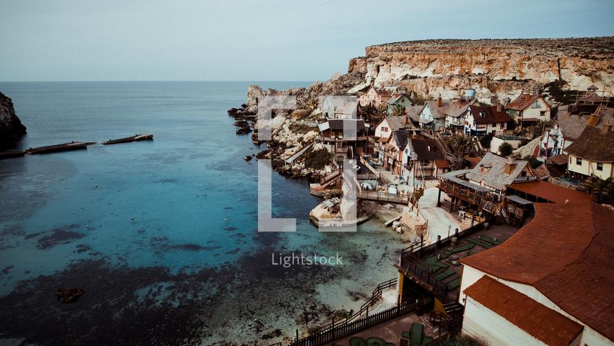 homes built into cliffs along a shore