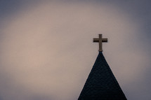 Church steeple roof with golden cross