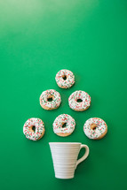 coffee mug and Christmas donuts in the shape of a Christmas tree