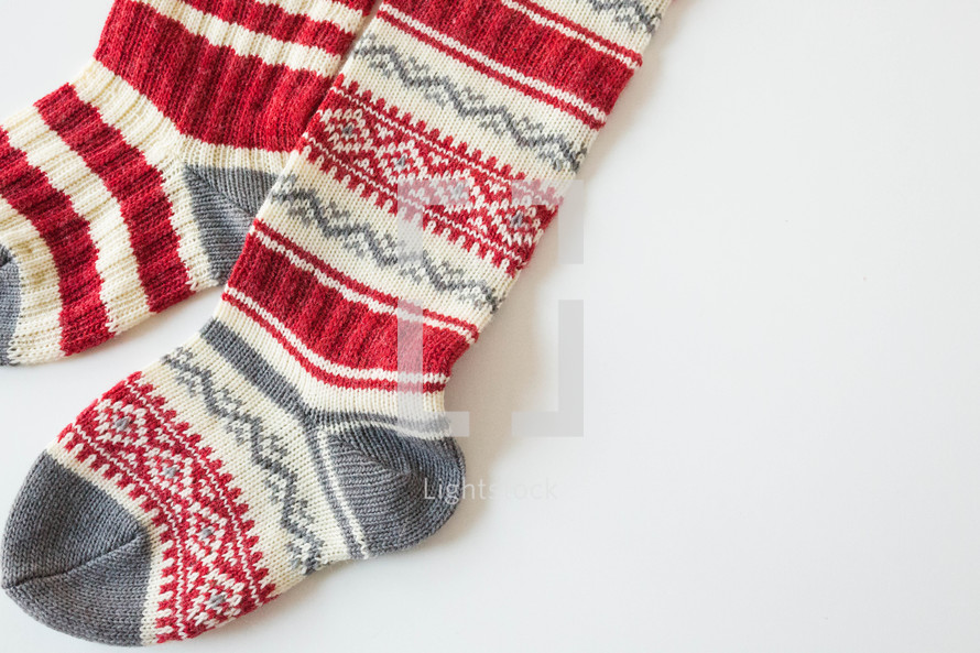 Knit christmas stockings on a white background — Photo by Rachel ...