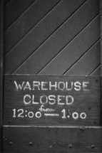 """Warehouse Closed"" sign; hours of operation."