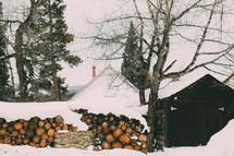snow on a wood pile