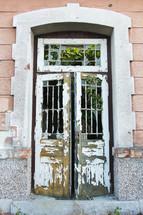 peeling paint on an old wooden door