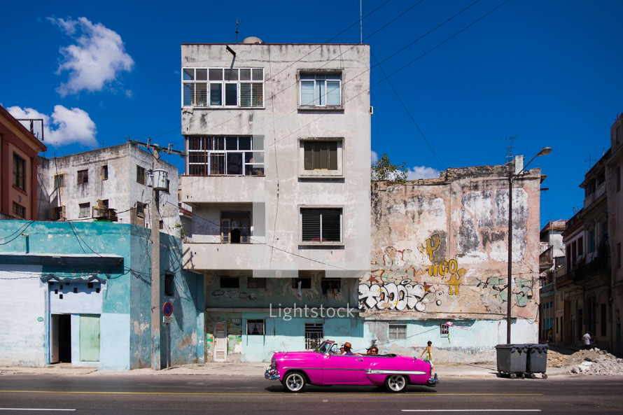 pink vintage car on the streets of Havana