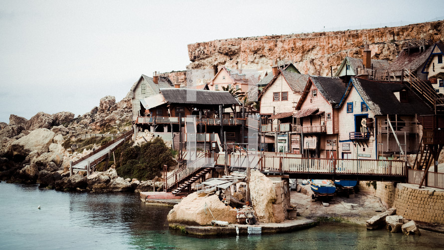 houses built into cliffs along a shore