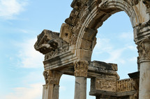 ancient columns and arch in ruins in Ephesus, Turkey