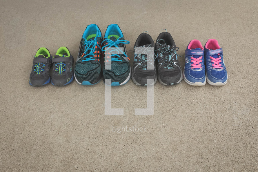 row of tennis shoes of a family