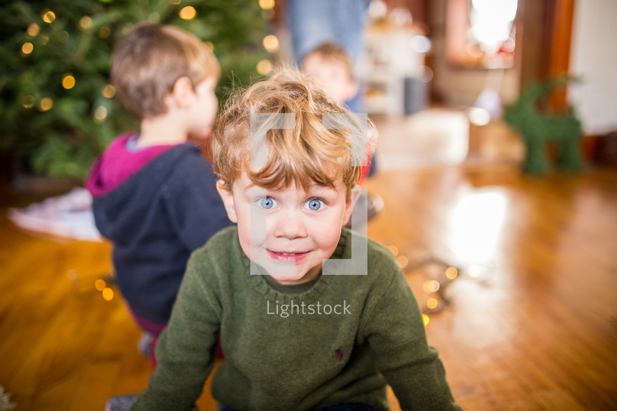 excited children decorating a Christmas tree
