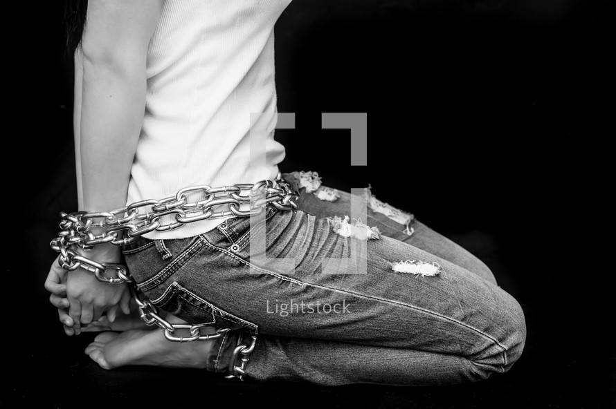 A chained woman.