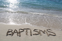 word baptisms written in the sand