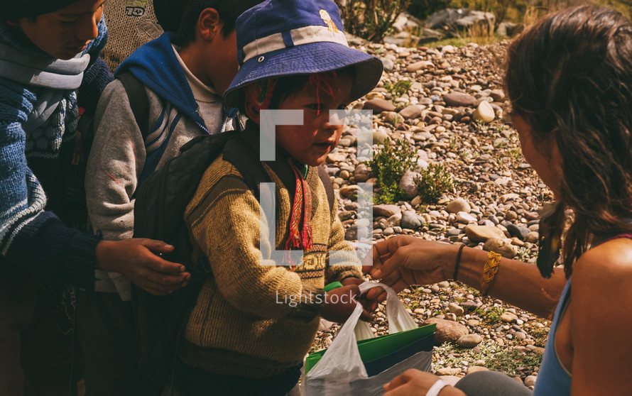 children waiting in line in Peru