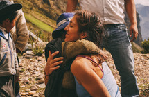 a woman hugging children in Peru