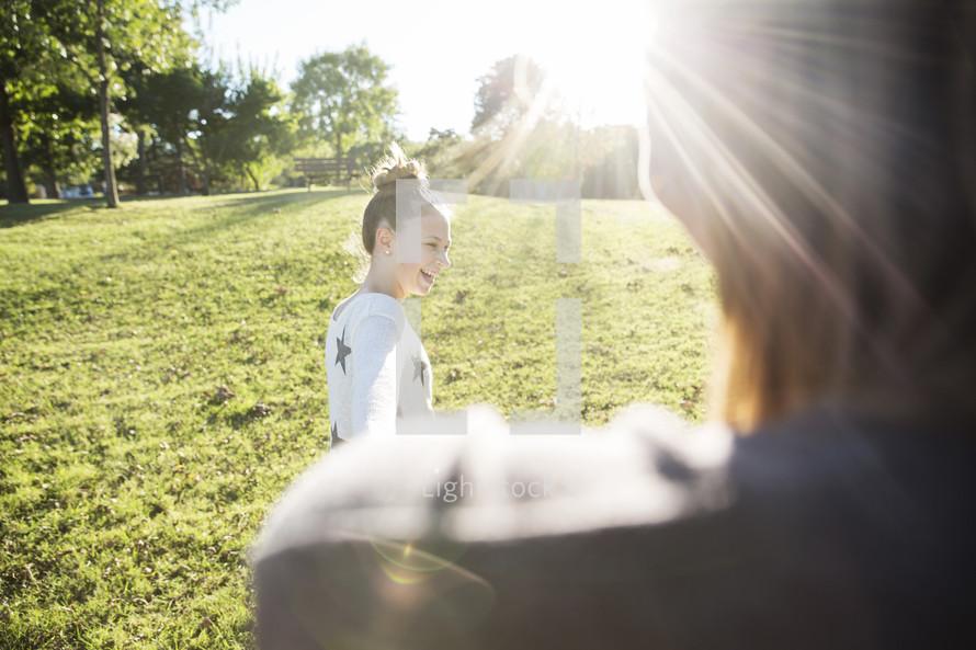 girl child standing outdoors under intense sunlight