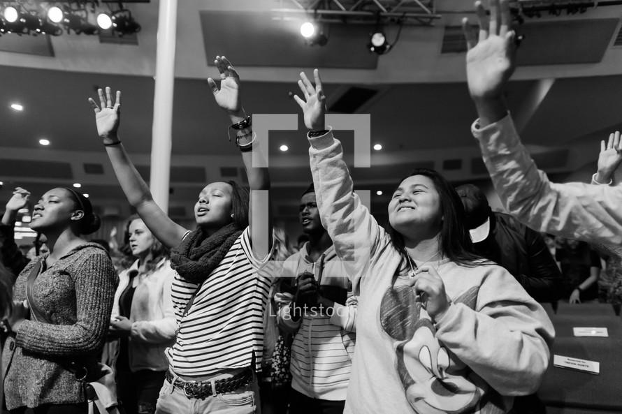teens praising God at a rally