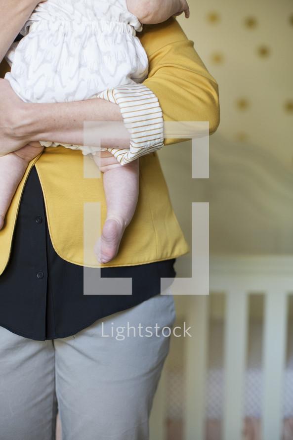 mother holding her infant