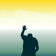 a silhouette of a man praising God