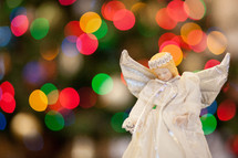 angel ornament and bokeh Christmas lights