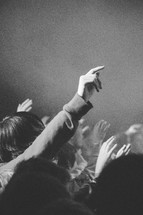 raised hands at a conference worship service